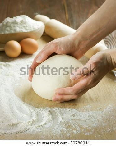 Kneading the Dough - stock photo