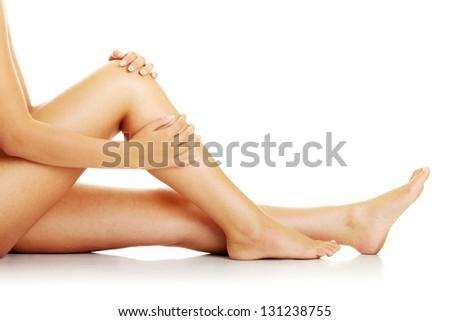 Knee Injury. Woman holding on sore knee.