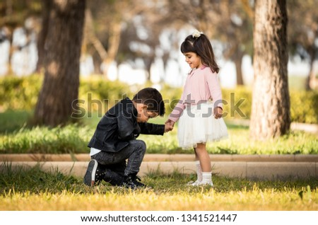 Kneeling boy Proposing - Boy proposing marriage with a romantic gesture his girlfriend