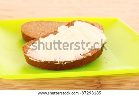 knife and a bread with butter on the plate