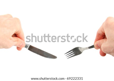 knife and fork in hands isolated on white background