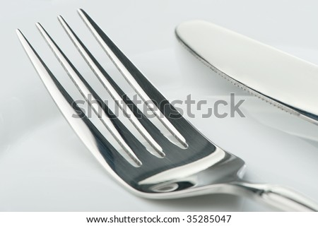 Knife and fork on a plate #35285047