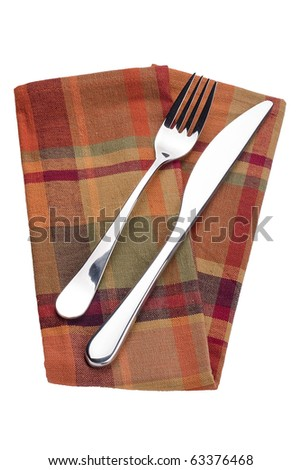 Knife and fork on a red napkin - tableware.