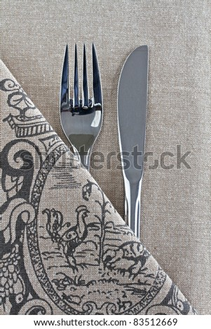 Knife and Fork on linen with design