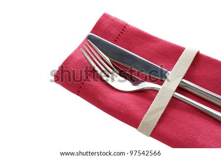 Knife and fork with pink napkin isolated on white background