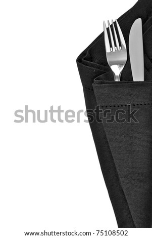 Knife and fork wrapped in a black napkin and isolated on white background with space for text