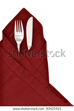 Knife and fork wrapped in red napkin as a table setting isolated on a white background