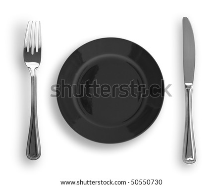 Knife, black plate and fork isolated