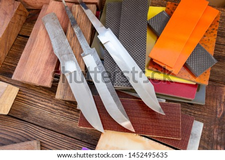 Knife blades, knife handle materials micarta, carbon, G10, acryl composite, wood, brass titanium cooper alloys plates, tubing, pins  for handmade DIY knife making supply wooden background #1452495635