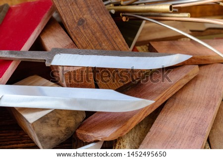 Knife blades, knife handle materials micarta, carbon, G10, acryl composite, wood, brass titanium cooper alloys plates, tubing, pins  for handmade DIY knife making supply wooden background #1452495650