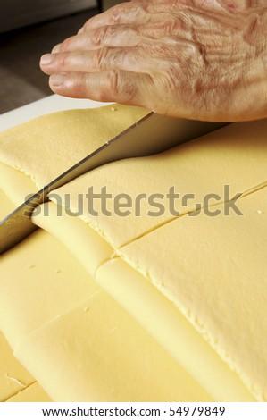 Knife cutting fresh pasta