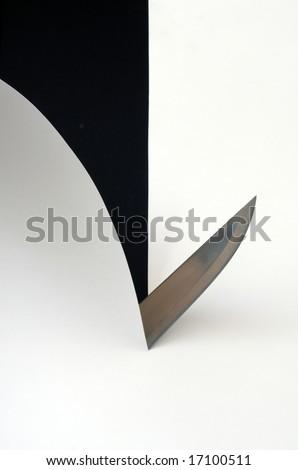 Knife cutting paper sheet