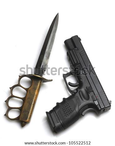 Knife to a Gunfight?/Automatic pistol arrayed next to Great War Trechknife