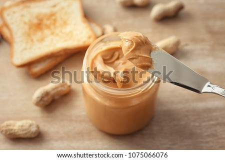 Knife with creamy peanut butter, closeup
