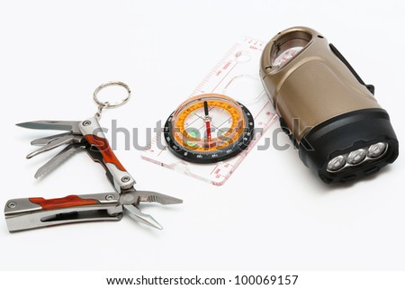 Knife with pliers, a compass and an electric torch