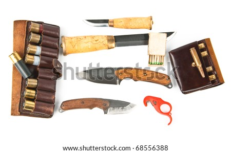 Knifes and ammunition for hunters over white.See more my hunting related photos: http://www.shutterstock.com/sets/46993-hunting.html?rid=522649