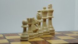 Knight chess is won by pawns on a wooden chessboard. Intellectual duel and tactical battle in business. Strategic planning, leadership, and teamwork. Checkmate and win in the game concept.