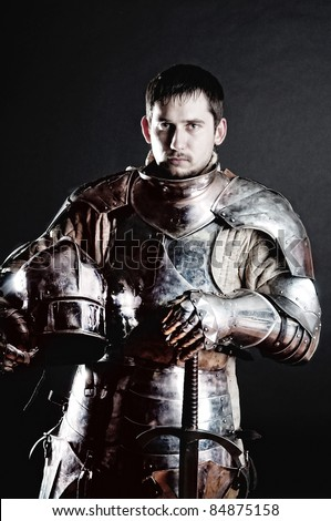Knight holding his helmet and sword