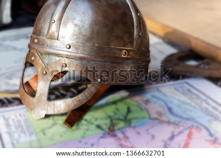 Knight's helmet and mitten for historical reconstructions of medieval battles. Clothes military. Knight's clothing. Knight armour.