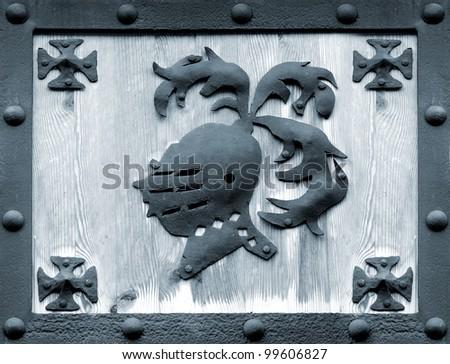 knight steel helmet symbol on wood in a frame