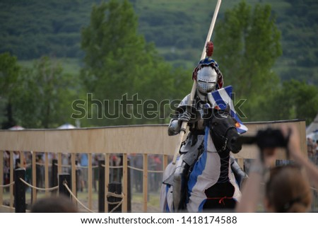 knight tournament on horseback with riders, in armor and with swords #1418174588