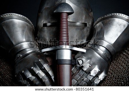 knights armor with helmet, chain mail, gloves and sword - stock photo