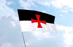 Knights Templar flag in front of blue sky