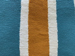 Knit pattern: light blue, cream, and gold stripes