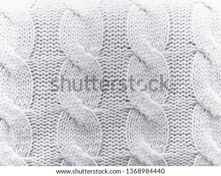 61410edc1d34 Knit texture of white wool knitted fabric with cable pattern as background.  Pattern