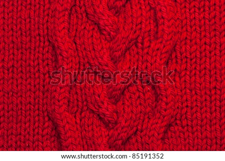 Knit woolen texture. Fabric red background