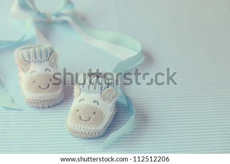 baby shoes for boy on a blue background. Greeting card. - stock photo