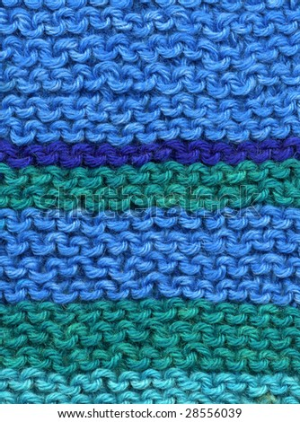 Knitted blue and green wool stripes abstract texture background.