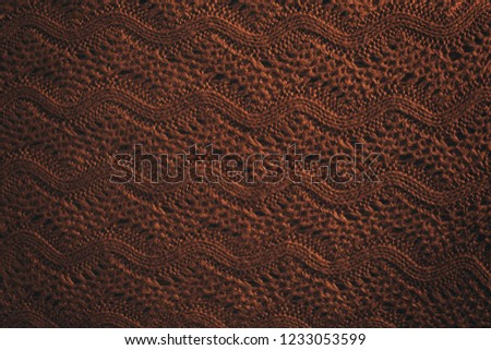 Knitted brown sweater pattern background. Natural woolen fabric, sweater fragment. Copy space. Copy space. #1233053599