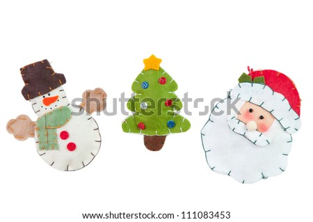 Knitted Christmas decorations: Snowman, green Christmas tree and Santa, isolated on white