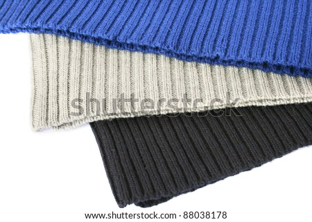 Knitted colorful wool cloths on white background.