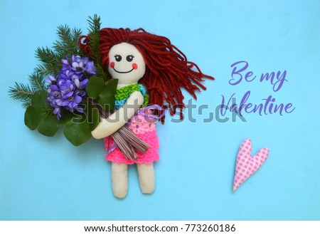 Knitted doll with pink heart on blue background #773260186