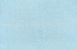 Knitted fabric with little loops. Light blue textile structured.