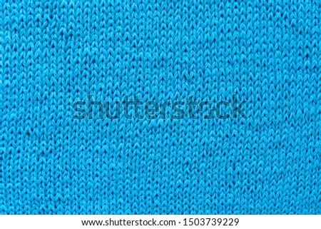 Knitted fabrics. Background of a knitted fabrics.