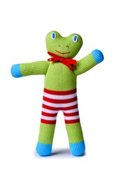 Knitted frog isolated on white background.