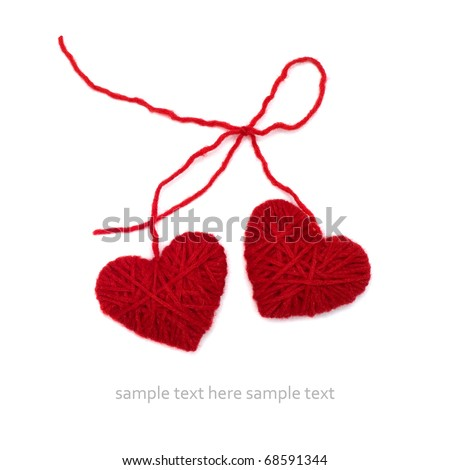 Knitted hearts on the white isolated