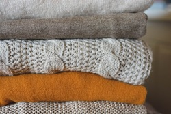 Knitted jumpers in neutral tones