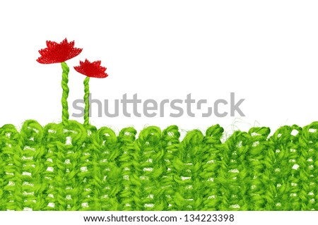 Knitted landscape with text space, green grass and flowers