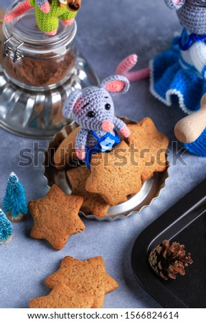 Knitted mouse family is cooking cookies. Year of rat. symbol of 2020. #1566824614