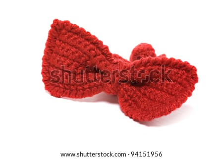 knitted red baby bow tie isolated on white background