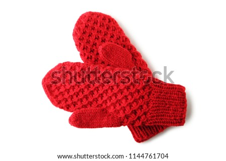 Knitted red gloves isolated on white background