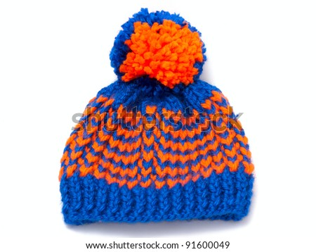 knitted scarf and cap with fringe on white background