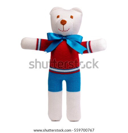 Knitted teddy bear isolated on white background.