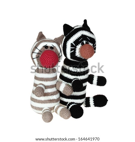Knitted toys two tabby cat isolated on white background - stock photo