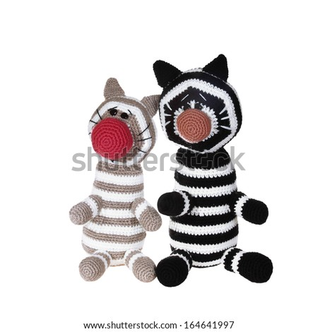 Knitted toys two tabby cat isolated on white background