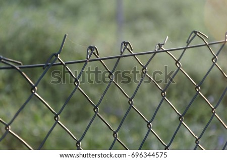 Knitted wire fence #696344575